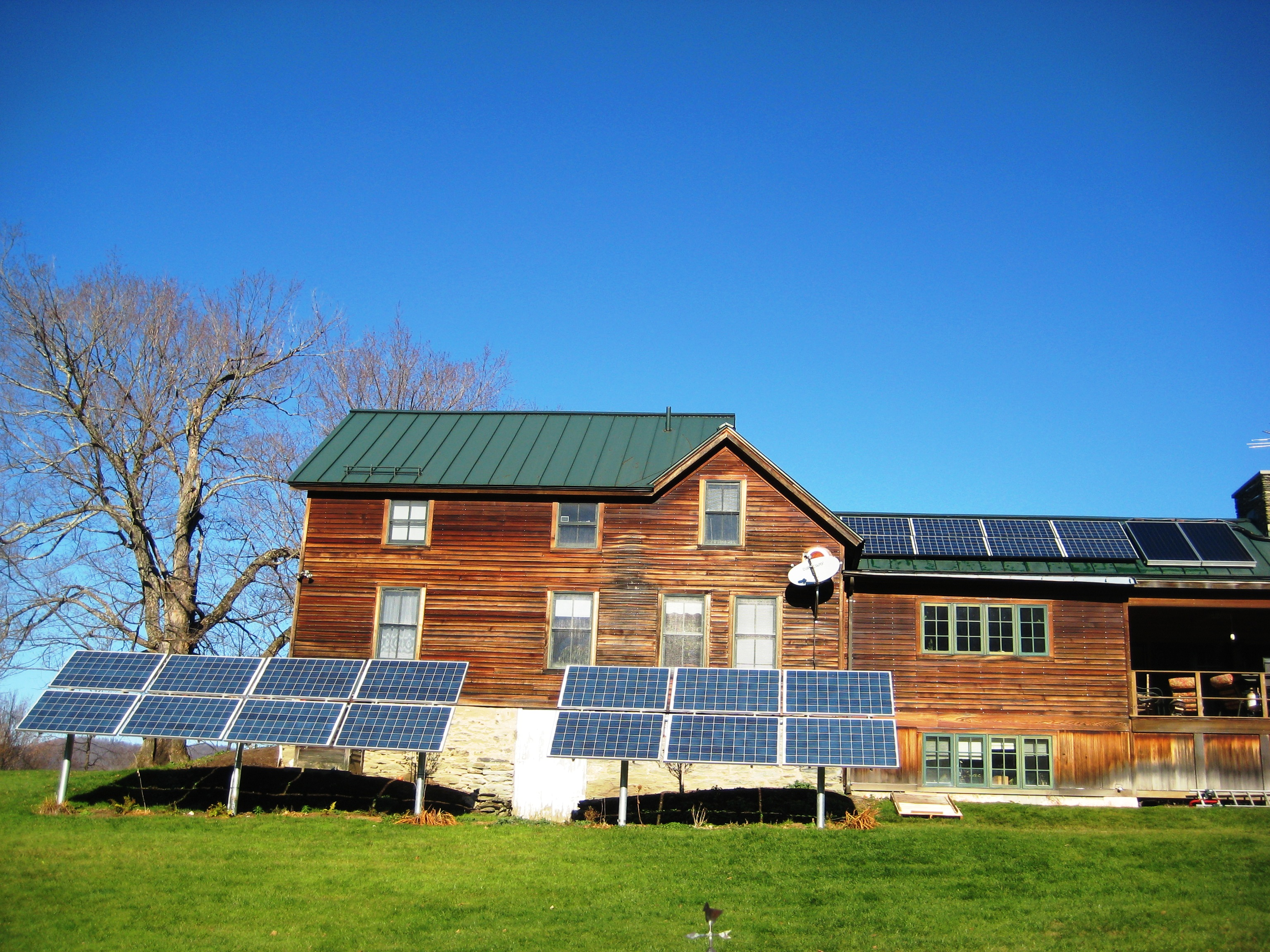 Combination roof and ground mount solar array with solar hot water collectors in Shaftsbury VT